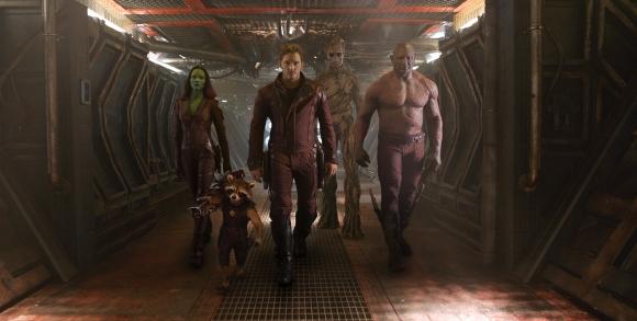 Gamora (Zoe Saldana), left, Rocket Racoon (voiced by Bradley Cooper), Peter Quill/Star Lord (Chris Pratt), Groot (voiced by Vin Diesel), and Drax (Dave Bautista) being badass.